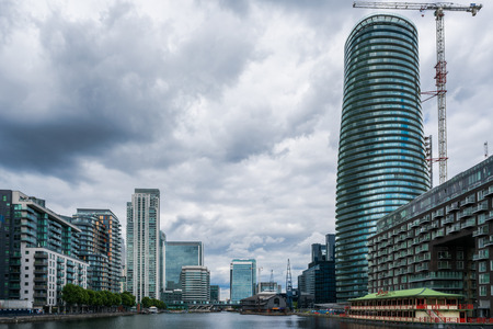 kingdoms: LONDON, UK - JULY 31, 2016: View of Canary Wharf, a major business district in London. Its one of United Kingdoms two main financial centers in London and contains many of Europes tallest buildings