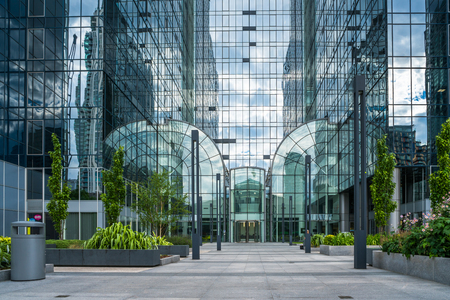 plc: LONDON, UK - JULY 31, 2016: Exchange Tower in the heart of Docklands is a modern office building occupied by businesses such as Barclays PLC, The Financial Ombudsman Service and American Eagle Tankers
