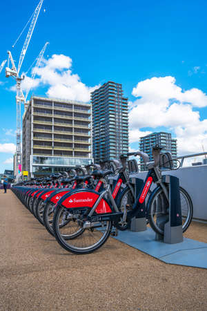 LONDON, UK - AUGUST 7, 2016:A row of Santander Cycles in the Olympic park. Santander Cycles is a public bicycle hire scheme in London. The cycles can be rented at the docking terminals around the city Editorial