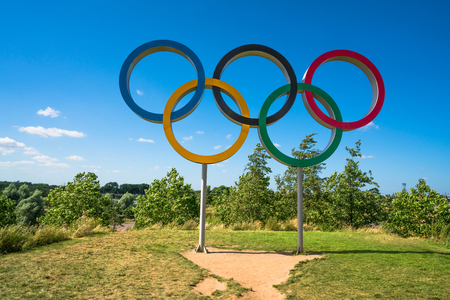 olympic ring: LONDON, UK - AUGUST 7, 2016: The Olympic Games symbol in the new Queen Elizabeth Olympic Park, a legacy from the games in the large landscaped public recreation area at Stratford, London, UK.