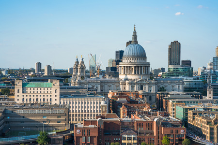 LONDON UK - AUGUST 30, 2016: Panoramic aerial view of The City of London with St. Pauls cathedral and modern office buildings in London