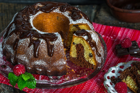 Home baked marble bundt cake on rustic wooded table