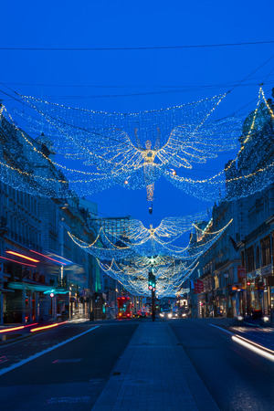 regent: LONDON - NOVEMBER 19, 2016: Christmas lights on Regent Street, London, UK. The Christmas lights attract thousands of shoppers during the festive season and are a major tourist attraction in London Editorial