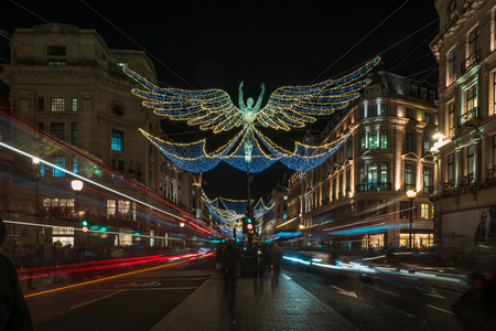 regent: LONDON - NOVEMBER 25, 2016: Christmas lights on Regent Street, London, UK. The Christmas lights attract thousands of shoppers during the festive season and are a major tourist attraction in London Editorial