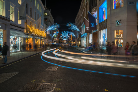 bond street: LONDON - NOVEMBER 25, 2016: Christmas lights on New Bond Street. The already glamorous area has been given a glittering makeover for the Christmas season with sprays of peacock-inspired decorations.