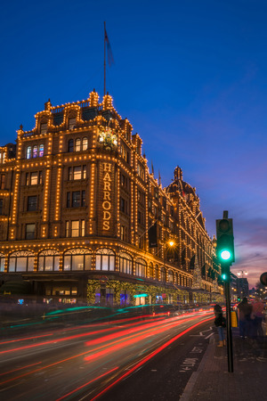 bond street: LONDON - NOVEMBER 26, 2016: View of Harrods with christmas decorations. The store, formerly owned by Mohamed Al-Fayed, then sold to Qatar Holdings is one of the most famous luxury stores in London.