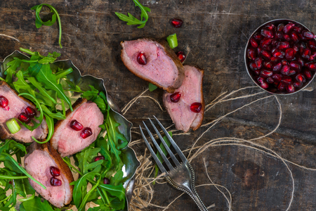 Crispy warm duck salad with pomegranate seeds - top view Stock Photo