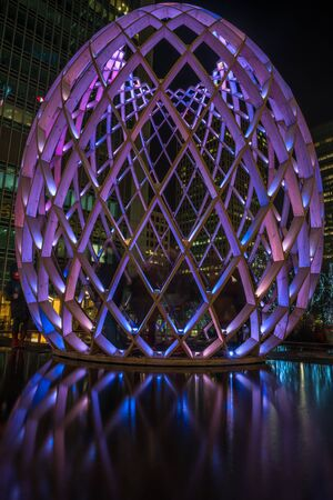 wharf: LONDON, UK - JANUARY 21, 2017: Winter Lights at Canary Wharf includes large light installation OVO by OVO COLLECTIVE. On entering OVO, visitors are surrounded by light and soundscapes. Editorial