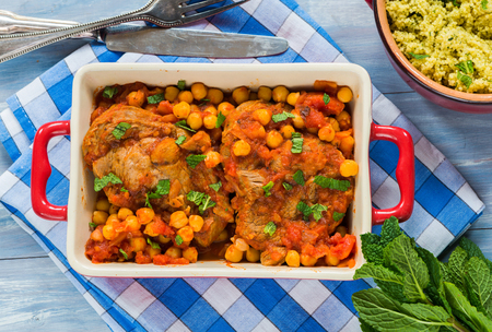 minted: Harissa lamb chops with chickpeas and minted couscous - top view Stock Photo