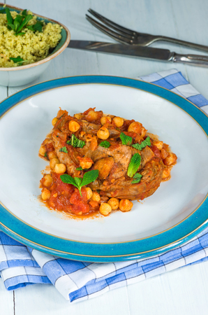minted: Homemade Harissa lamb chops with chickpeas and minted couscous - top view