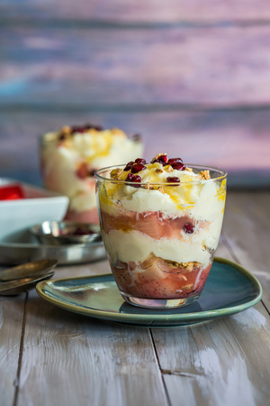 trifle: White chocolate mousse with poached rhubarb garnished with pomegranate seeds