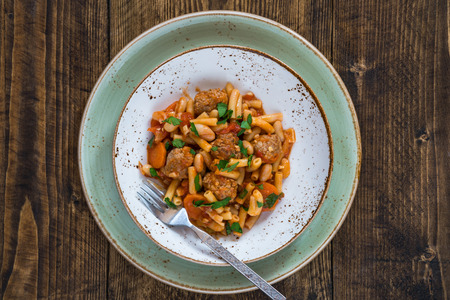italian sausage: Bean and pasta stew with meatballs - top view