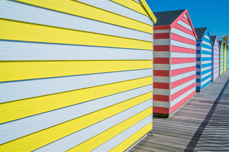 substructure: Colorful wooden huts on Hastings pier