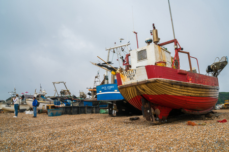 HASTINGS, UK - MAY 13 2017: Old fishermen boats on seafront in Hastings old town. Located on the south coast of Sussex, Hastings is home to the UK�s largest beach-launched fleet and fishing community