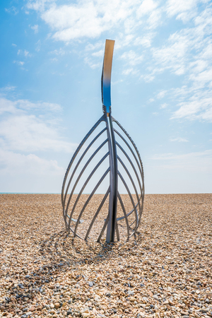 HASTINGS, UK - MAY 13 2017: Sculpture The Landing rising from the shingle on Hastings beach was created by local sculptor Leigh Dyer in collaboration with the British Artist Blacksmiths Association