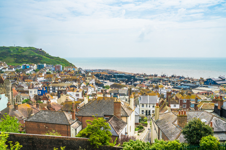 HASTINGS, UK - MAY 13 2017: View of old town and seafront from  West Hill in Hastings, East Sussex, UK. The town is a popular seaside resort and a fishing port with a beach-based fishing fleet.