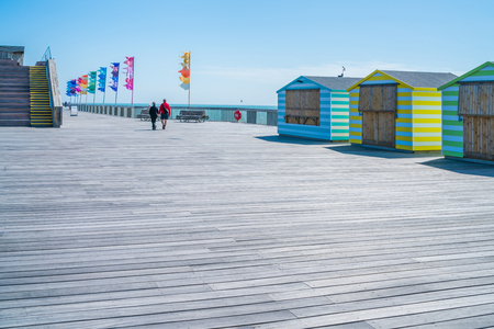 substructure: HASTINGS, UK - MAY 13 2017:  People strolling on new Hastings pier. the pier was rebuilt and open to public in 2016 after the old  pier suffered extensive fire damage in October 2010