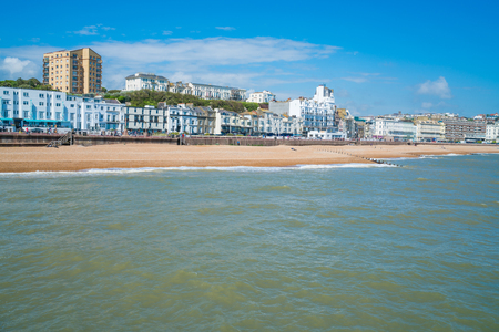 HASTINGS, UK - MAY 13 2017: View of Hastings town and beach front from Hastings Pier. The town is a popular seaside resort and a fishing port with a beach-based fishing fleet. East Sussex England UK.