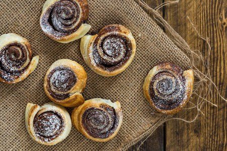 Chocolate hazelnut pinwheels dusted with icing sugar - top view