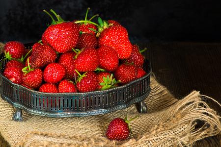 Fresh strawberries on rustic background