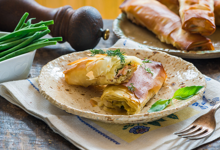 Salmon and basil butter filo parcels with green beans