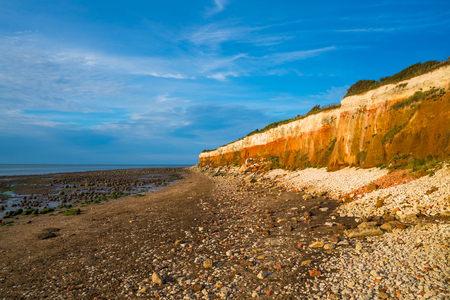 View of the beach with chalk and brownstone cliffs in Hunstanton, Norfolk UK