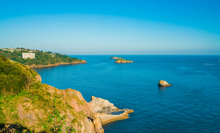 View of coast and sea in Torquay, South Devon, UK - Thatcher Point and Thatcher Rock Stock Photo