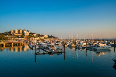 TORQUAY, DEVON UK - OCTOBER 14, 2017: View of the harbor in Torquay. Torquay, a seaside town in Devon, also known as English Riviera, is a fashionable holiday resort and a popular tourist destination Editorial