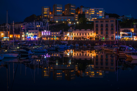 TORQUAY, DEVON UK - OCTOBER 14, 2017: Night view of the harbor in Torquay. Torquay, a seaside town in Devon, also known as English Riviera, is a fashionable holiday resort and a popular tourist destination Editorial