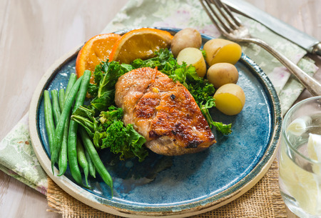 Roast duck fillets with orange marmalade and chilli glaze with boiled potatoes and green vegetables