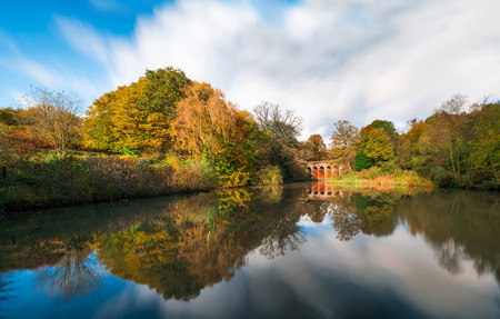 Wide panoramic view of an old viaduct in Hampstead Heath park in the fall season. London UK