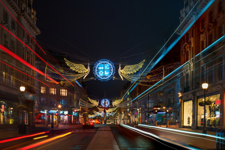 regent: LONDON - NOVEMBER 18, 2017: Christmas lights on Regent Street, London, UK. The Christmas lights attract thousands of shoppers during the festive season and are a major tourist attraction in London