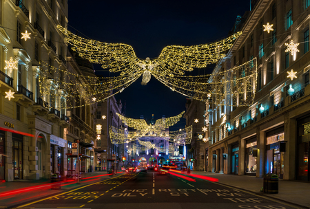 LONDON - NOVEMBER 25, 2017: Christmas lights on Regents Street St James. Beautiful Christmas decorations attract thousands of shoppers during the festive season and are a major tourist attraction. Editorial