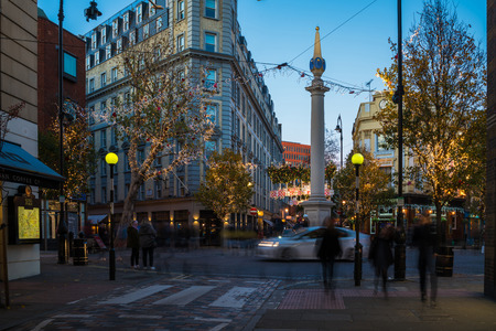 LONDON - NOVEMBER 25, 2017: Christmas street decorations at Seven Dials in Covent Garden area attract thousands of people during the festive season and are a major tourist attraction in London.
