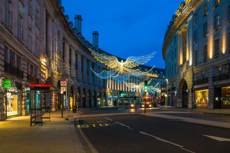 LONDON - NOVEMBER 25, 2017: Christmas lights on Regent Street, London, UK. The Christmas lights attract thousands of shoppers during the festive season and are a major tourist attraction in London Editorial