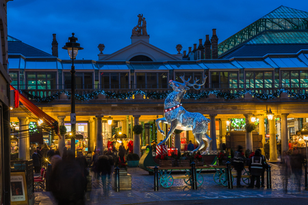 LONDON - NOVEMBER 30, 2017: A magnificent silver reindeer standing on the east side of the piazza in Covent Garden attracts thousands of  Londoners and tourists during the festive season. Editorial