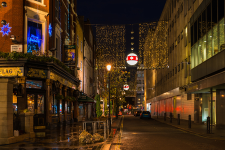 LONDON, UK - DECEMBER 2ND, 2017: Christmas lights on James Street, a popular destination for West End shoppers, attract thousands of Londoners and tourists during the festive season