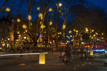 LONDON, UK - DECEMBER 09, 2017: Christmas Lights decorations on Sloane Square - a lovely, fashionable,  pedestrianized area in the Royal Borough of Kensington and Chealse