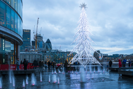 LONDON, UK - DECEMBER 16, 2017: A large contemporary LED Christmas tree decorates the riverside outside City Hall, London Borough of Southwark