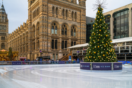 LONDON, UK - DECEMBER 16, 2017: Ice rink and Christmas tree at National History Museum, one of the most famous and visited tourist attractions in London.
