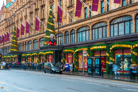 LONDON, UK - DECEMBER 16, 2017: Harrods store facade decorated for Christmas. The famous store in Knightsbridge, London, is a must-visit attraction for tourists  from all over the world. Editorial
