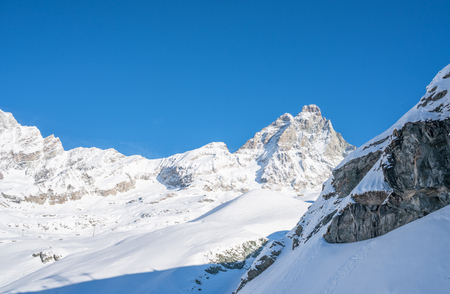 View of Italian Alps and Matterhorn Peak in Cervinio ski resort in the winter, Italy