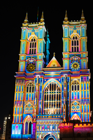 LONDON, UK - JANUARY 18, 2018: As part of Lumiere London, Patrice Warrener's The Light of the Spirit projection brings Great West Gate of the Westminster Abbey to life