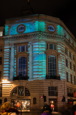 LONDON, UK - JANUARY 18, 2018: As part of Lumiere London Holger Mader and Heike Wiermanns light video piece Frictions projected on 103 Regents Street seemingly makes the building change form. Editorial