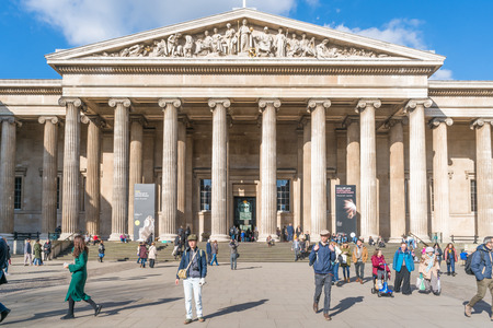 LONDON FEBRUARY 17, 2018:Tourists visit British Museum. Established in 1753, vastly based on the collections of the physician and scientist Sir Hans Sloane, it first opened to the public on 15/01/1759