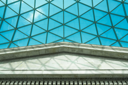 LONDON FEBRUARY 17, 2018: The glass ceiling above the Great Court in British Museum. The roof is glass and steel construction designed by engineers Buro Happold and architects Foster and Partners.