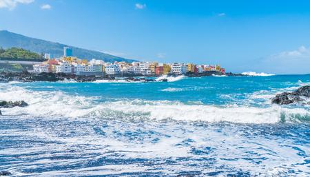 Puerto de la Cruz, Tenerife, Canary Islands - view of colorful houses, sea and volcanic-sand beach Stock Photo