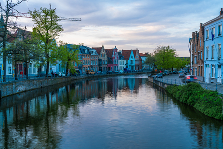 BRUGES, BELGIUM - APRIL 22, 2018: Bruges, the capital of West Flanders in northwest Belgium and popular tourist destination is distinguished by its canals, cobbled streets and medieval buildings