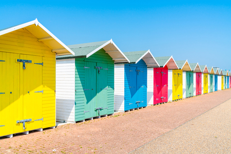 A row of colorful wooden beach huts on the beach in Eastbourne, East Sussex, UK Banque d'images - 103852272