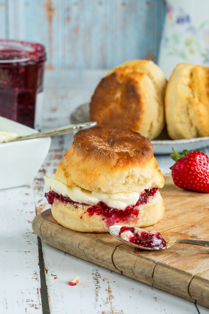 Traditional English scones with strawberry jam and clotted cream